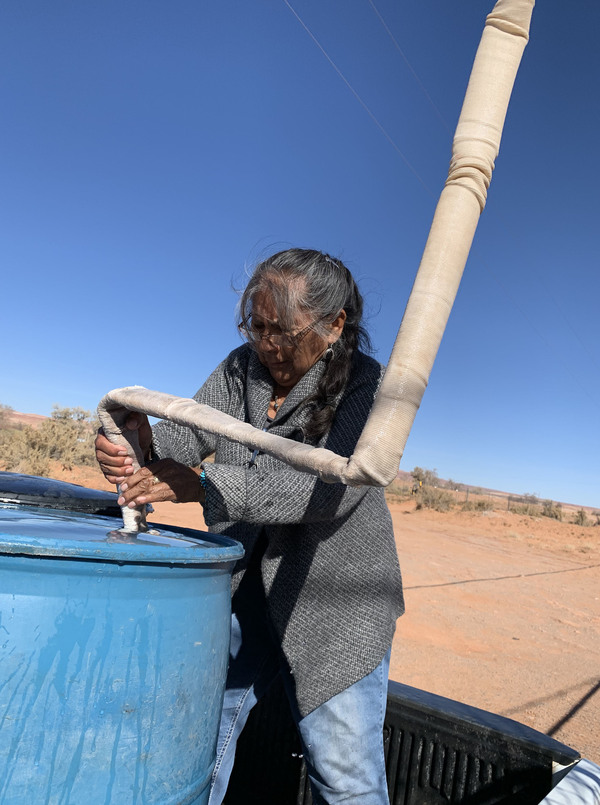Darlene Yazzie, a retired community health worker, says hauling water, firewood and trash, as well as using an outhouse, are just a few of the things that make life hard on the Navajo Nation.
