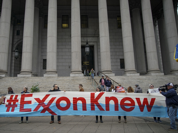 Environmental activists rally outside of New York Supreme Court in October in Manhattan, the first day of the trial accusing ExxonMobil of misleading shareholders about its climate change accounting.