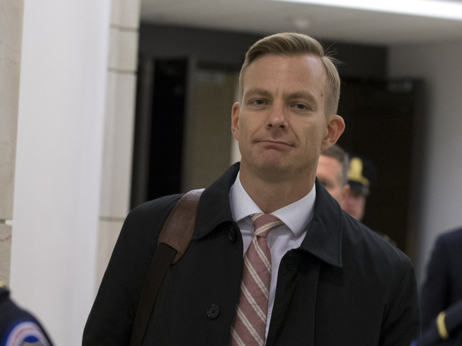 David Holmes, a career diplomat, leaves Capitol Hill on Nov. 15 after a deposition before congressional lawmakers as part of the House impeachment inquiry into President Trump. (Jose Luis Magana/AP)
