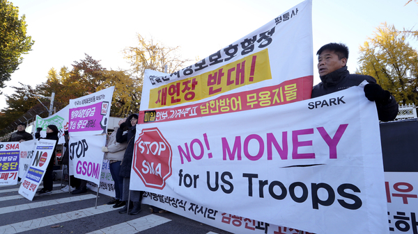 Protesters in Seoul, South Korea, on Nov. 14 march ahead of a visit by U.S. Defense Secretary Mark Esper.