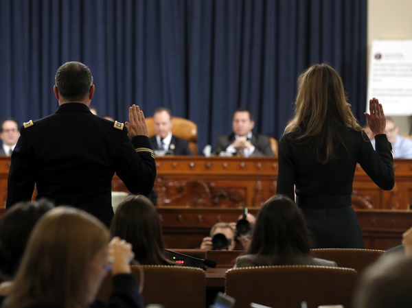 Jennifer Williams (right) and Lt. Col. Alexander Vindman are sworn in to testify before the House Intelligence Committee on Capitol Hill Tuesday.