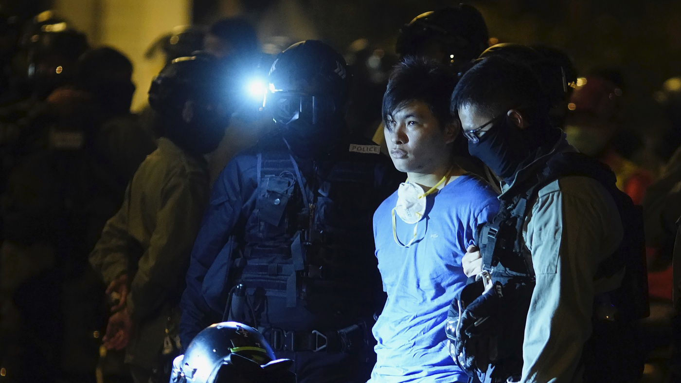 Hong Kong Standoff At University Grinds On; Protesters Attempt Escape In Sewers - NPR