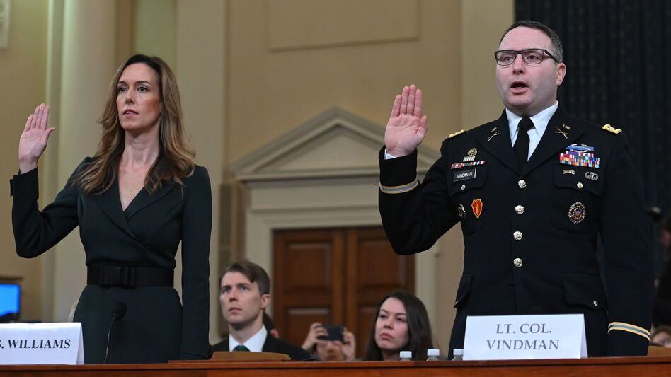 Jennifer Williams and Lt. Col. Alexander Vindman take the oath before testifying during the House Intelligence Committee hearing on Tuesday. (Andrew Caballero-Reynolds/AFP via Getty Images)