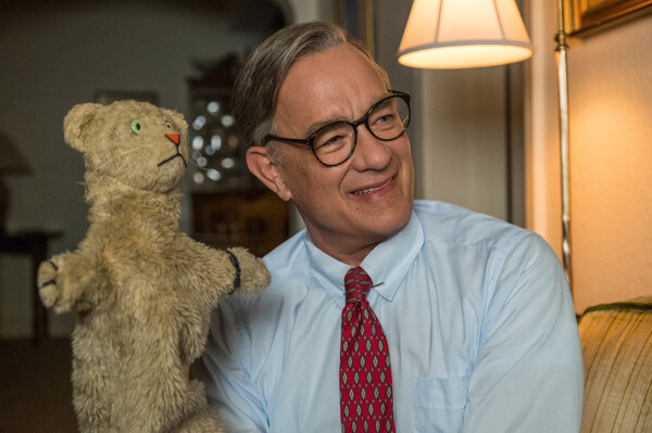 Tom Hanks stars as the beloved children's performer Fred Rogers in A Beautiful Day in the Neighborhood.