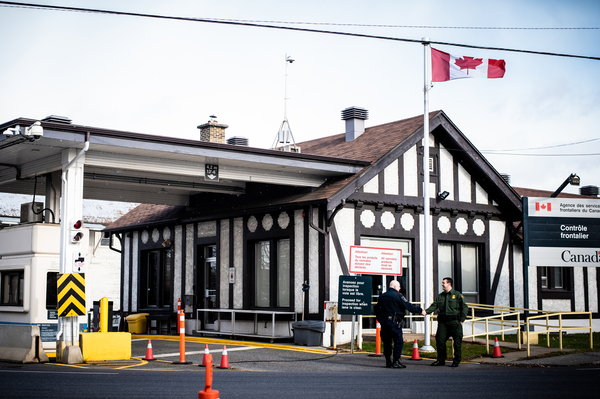 Richard Ross (right), patrol agent in charge of the U.S. Border Patrol's Newport Station, greets a Canadian Border agent at the Beebe, Quebec, and Beebe Plain, Vt., crossing.