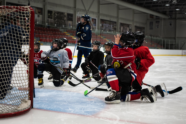 The Border Jets, a novice hockey team, practices at the Pat Burns Arena in Stanstead, Quebec. The team is made up of both Canadian and American players.