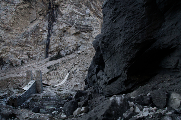 Shishper, a 9-mile-long, black glacier, is edging toward a wood-and-rope bridge that government-contracted workers are racing to dismantle.