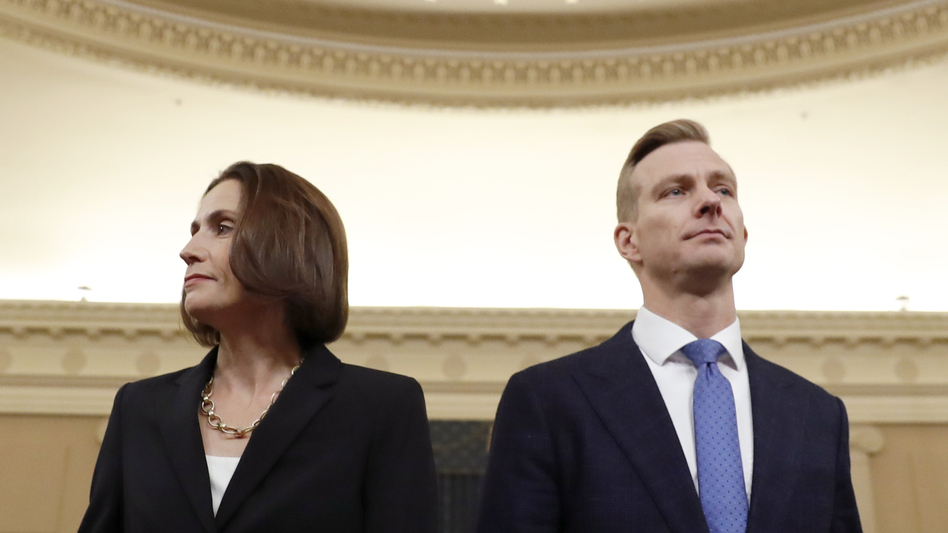 Former White House national security aide Fiona Hill and David Holmes, a U.S. diplomat in Ukraine, return from a break to continue their testimony before the House Intelligence Committee on Thursday. (Andrew Harnik/AP)