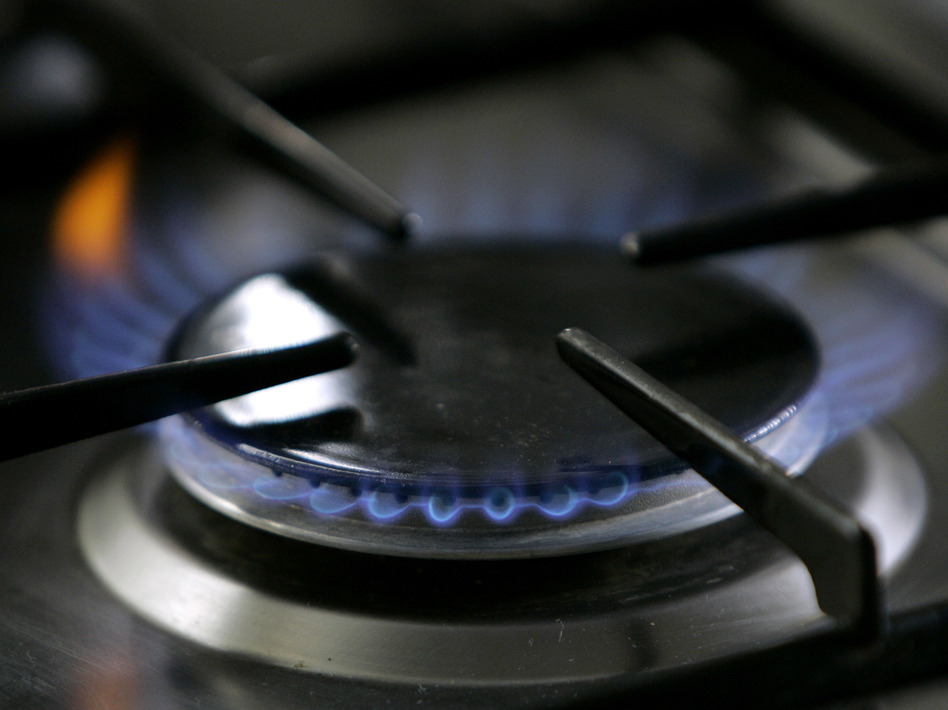 A gas-lit flame burns on a stove. A California restaurant organization is suing Berkeley over the city's ban on natural gas, which is set to take effect in January, 2020. (Thomas Kienzle/AP)