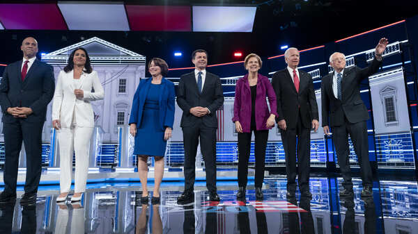 Candidates appear on stage at the start of the Democratic presidential debate at Tyler Perry Studios on Wednesday in Atlanta.