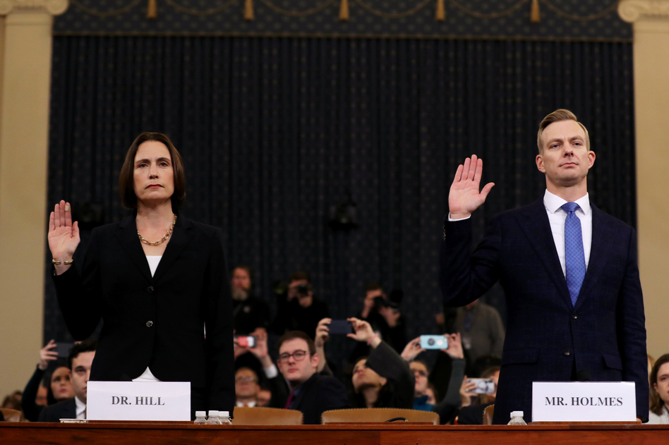 Fiona Hill (left), the National Security Council's former senior director for Europe and Russia, and David Holmes, an official from the American Embassy in Ukraine, are sworn in to testify before the House Intelligence Committee in the Longworth House Office Building on Capitol Hill on Thursday. (Chip Somodevilla/Getty Images)