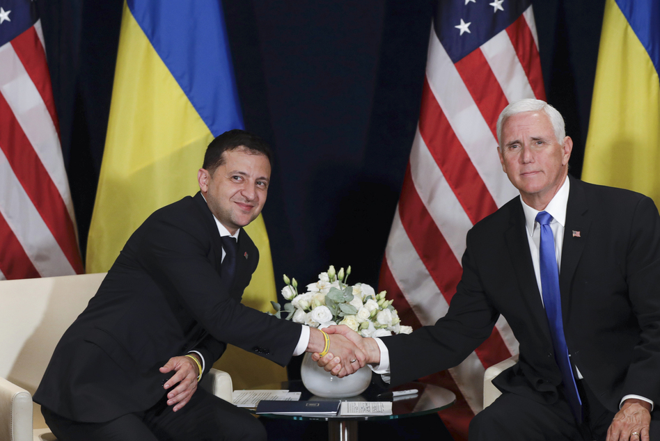 Ukrainian President Volodymyr Zelenskiy shakes hands with Vice President Pence in Warsaw, Poland, on Sept. 1. (Petr David Josek/AP)
