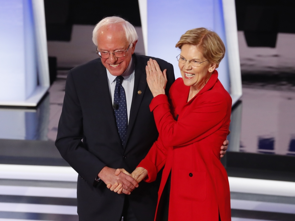 Sen. Bernie Sanders, I-Vt., and Sen. Elizabeth Warren, D-Mass., are proposing to forgive student debt for most Americans. They greet each other at a Democratic primary debate in July. (Paul Sancya/AP)