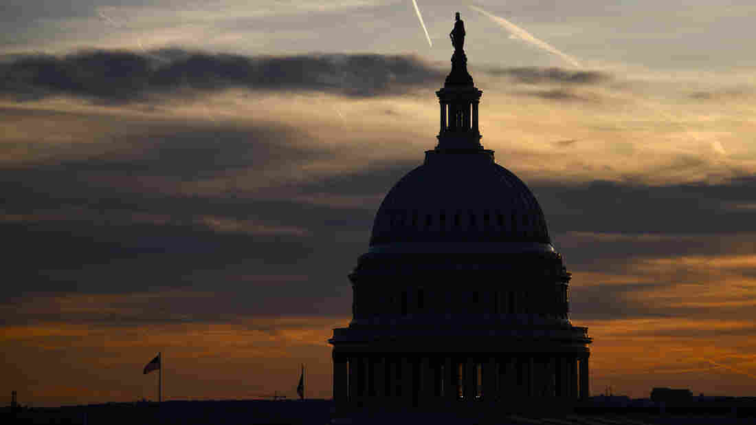 WASHINGTON, DC - NOVEMBER 13: Streaks in the sky form at sunset behind the U.S. Capitol Building on November 13, 2019 in Washington, DC.