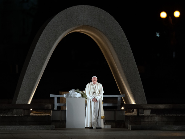 Pope Francis observes a minute of silence in memory of the victims of the atomic bombing of Hiroshima during his visit to the city's Peace Memorial Park on Sunday.
