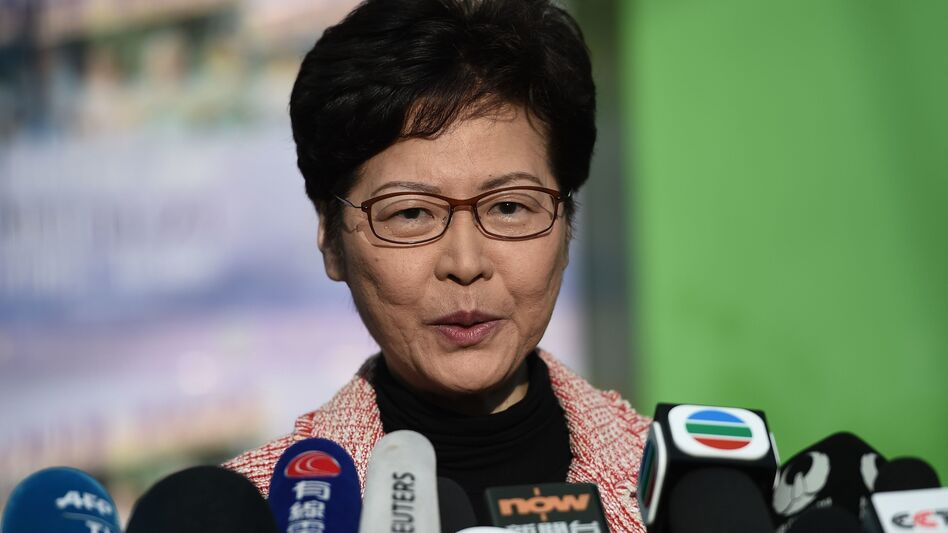 """Hong Kong Chief Executive Carrie Lam addresses the media after casting her vote during Sunday's district council elections. After results showed a landslide victory for pro-democracy candidates, Lam said she would listen """"humbly"""" to the will of the voters. (Ye Aung Thu/AFP via Getty Images)"""