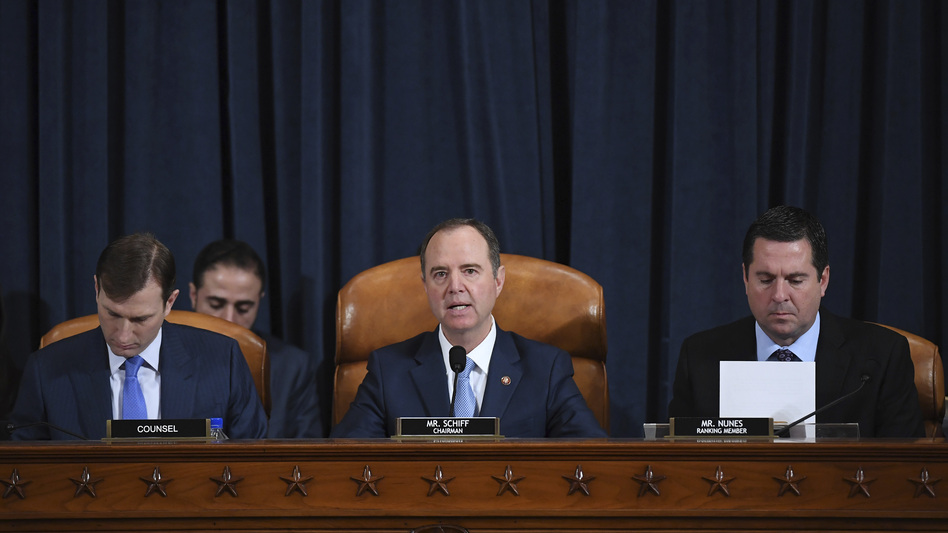 House Intelligence Committee Chairman Adam Schiff, D-Calif. (center); ranking member Rep. Devin Nunes of California (right); and committee counsel Daniel Goldman hold an impeachment inquiry hearing on Nov. 21. Schiff has released the panel's report on the inquiry. (Matt McClain/AP)