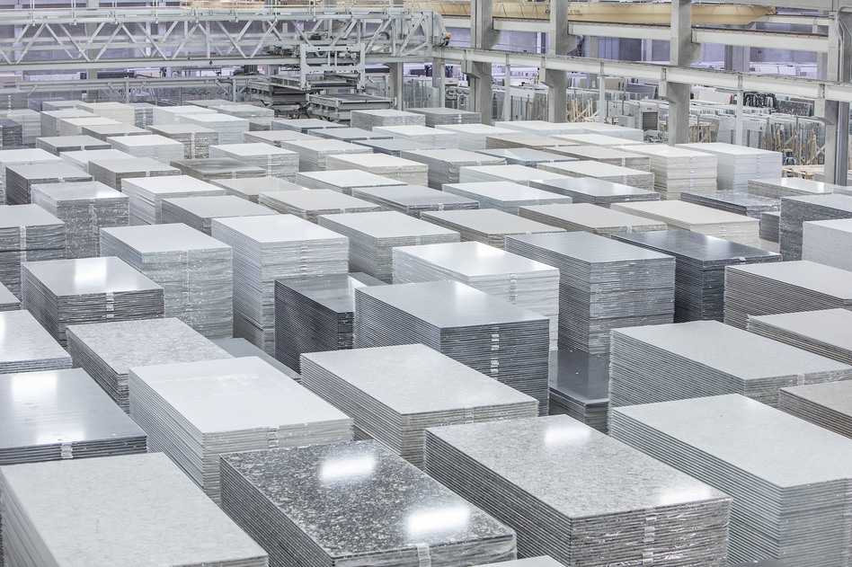 The Cambria factory in Minnesota manufactures slabs of engineered quartz for kitchen and bathroom countertops. If businesses don't follow worker protection rules, cutting these slabs to fit customers'<strong> </strong>kitchens can release lung-damaging silica dust. (Cambria)