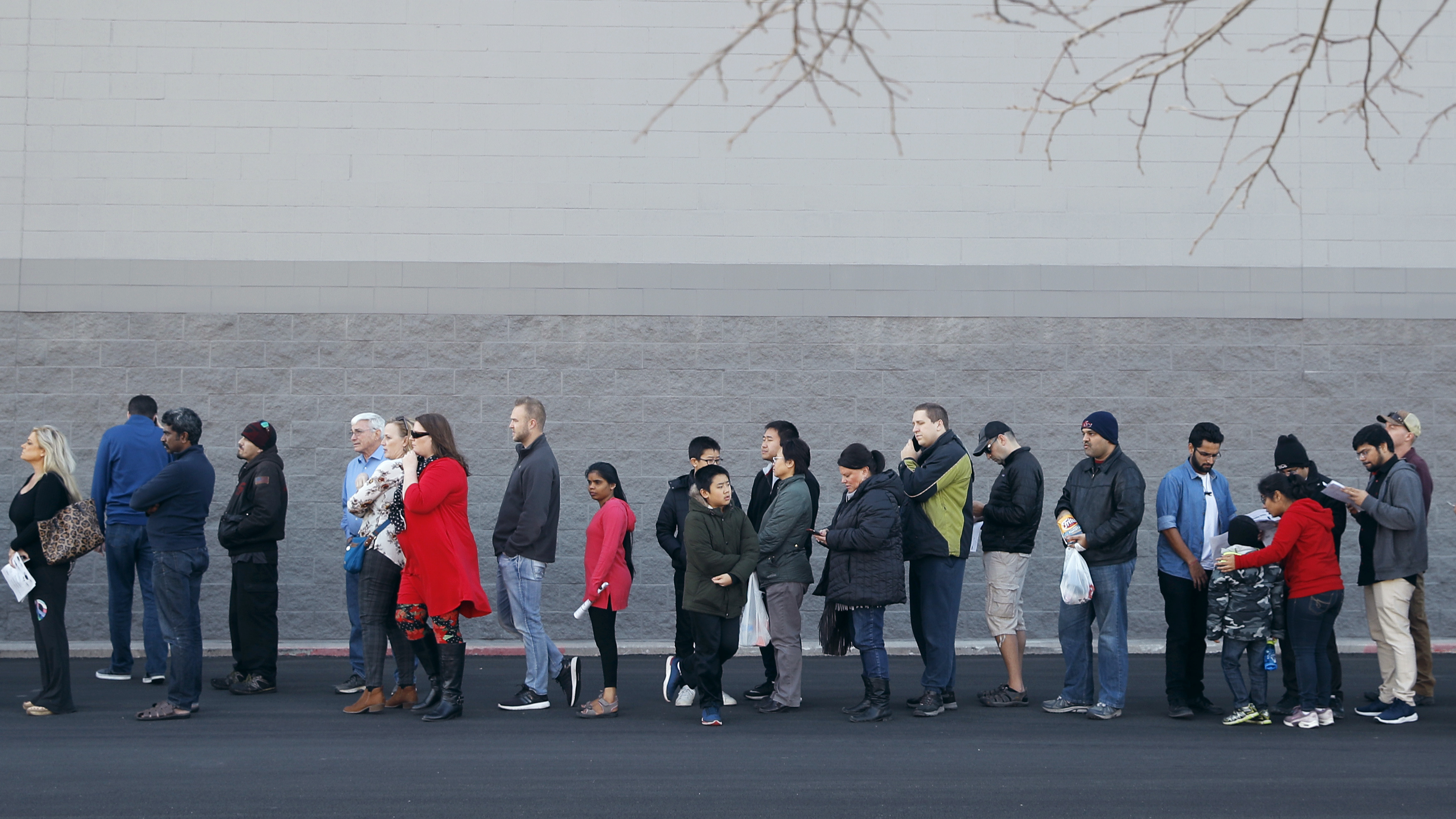 People wait in line for a Best Buy store to open for an early Black Friday sale on Thanksgiving Day 2018 in Overland Park Kan
