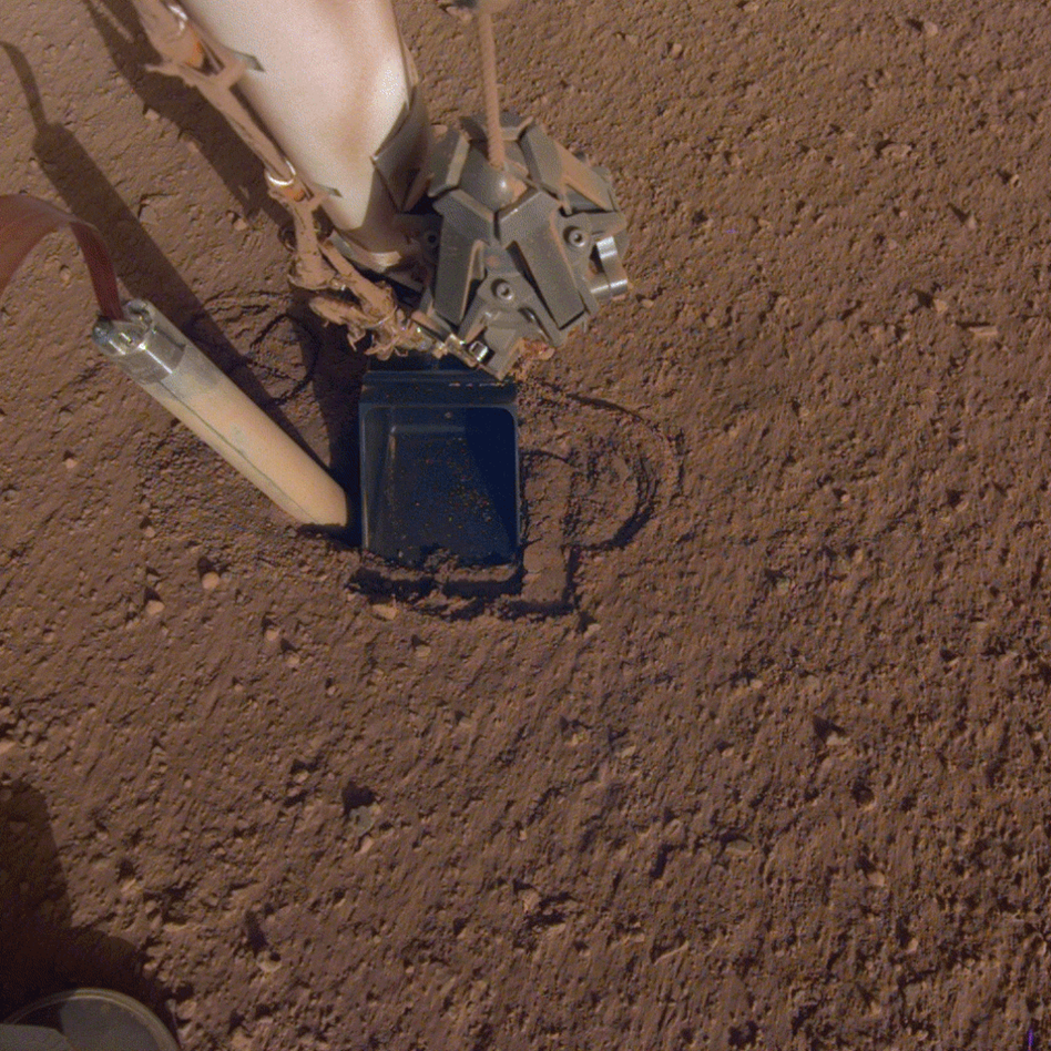 A photo of the mole on NASA's InSight lander trying to drill into the Martian surface. (NASA)