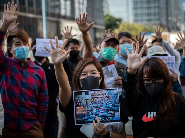 People gather in support of pro-democracy protesters during a lunch break rally in the Kwun Tong area in Hong Kong on Wednesday. Hong Kong has been battered by months of mass rallies and violent clashes between police and protesters who are demanding direct popular elections of the semi-autonomous Chinese territory's government, as well as an investigation into alleged police brutality.