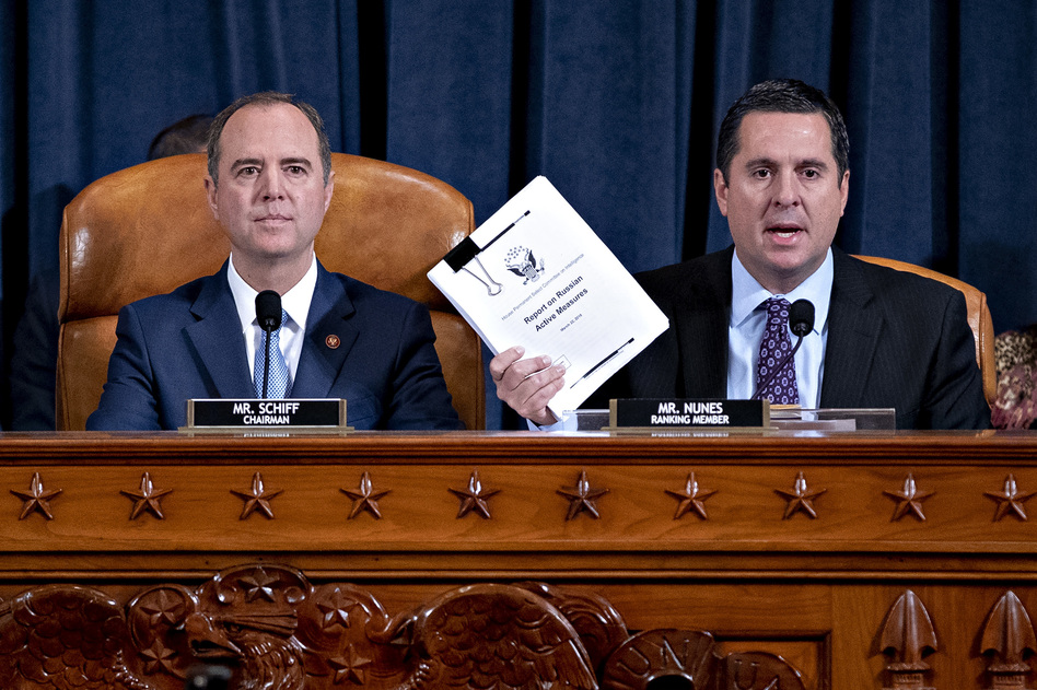 Rep. Devin Nunes, R-Calif., ranking member of the House Intelligence Committee (right), speaks as Rep. Adam Schiff, D-Calif., chairman of the House Intelligence Committee, listens during an impeachment inquiry hearing on Capitol Hill on Nov. 21. (Andrew Harrer/Getty Images)