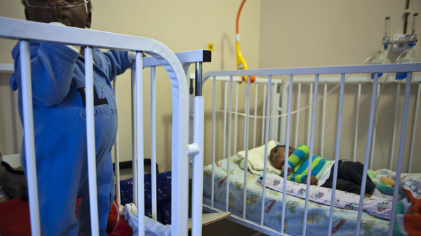 Babies in their cribs at Lambano Sanctuary, a hospice for orphaned children with HIV in Gauteng, South Africa.