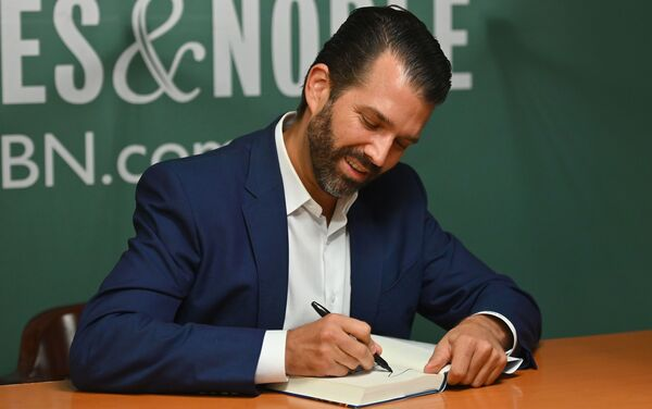 Donald Trump Jr., signs his new book Triggered at the 5th Avenue Barnes & Noble in New York.