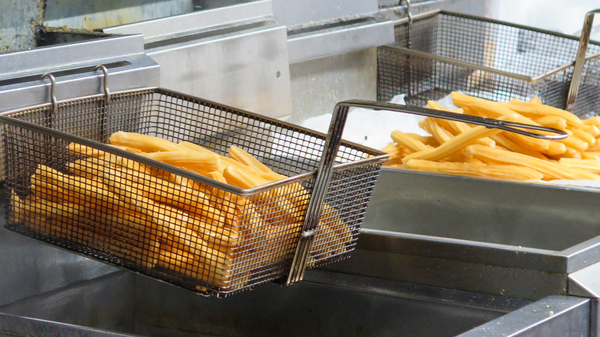 At La Palma Calle Ocho in Miami, the churros are pulled hot from a fryer, placed into brown paper bags and drenched in granulated sugar.
