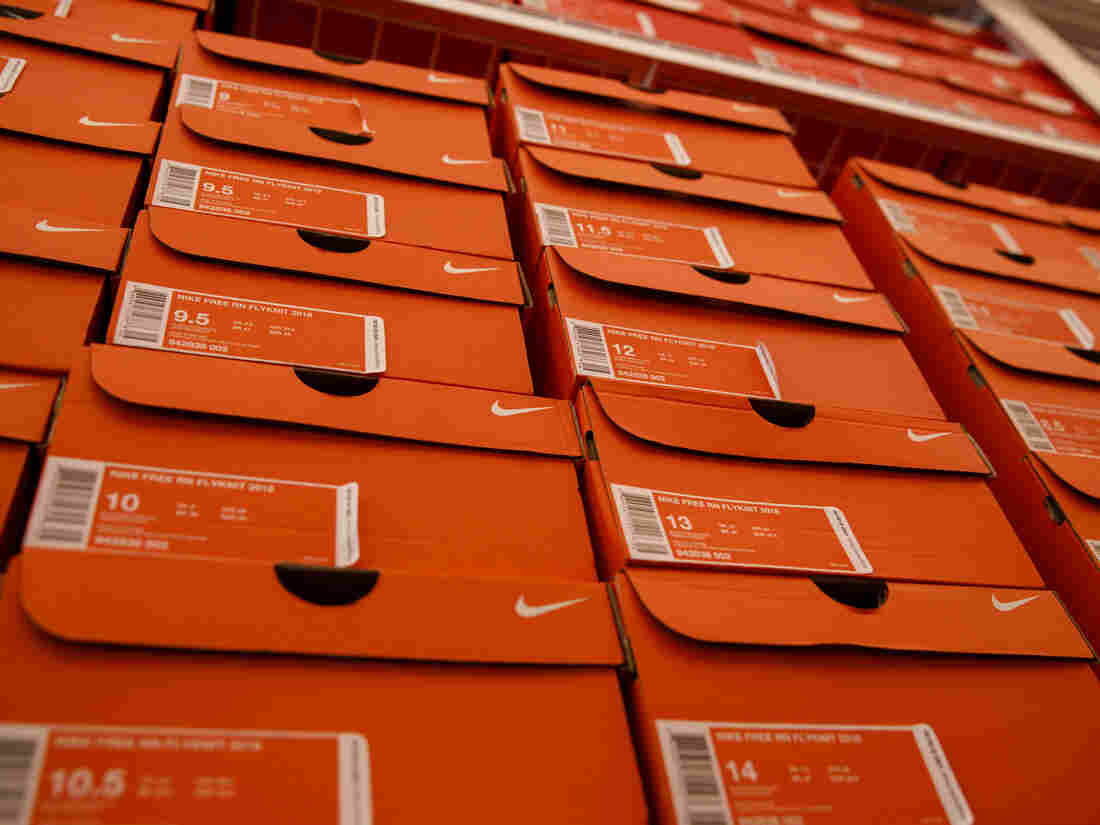 Boxes of sneakers sit stacked at the Nike by Melrose.