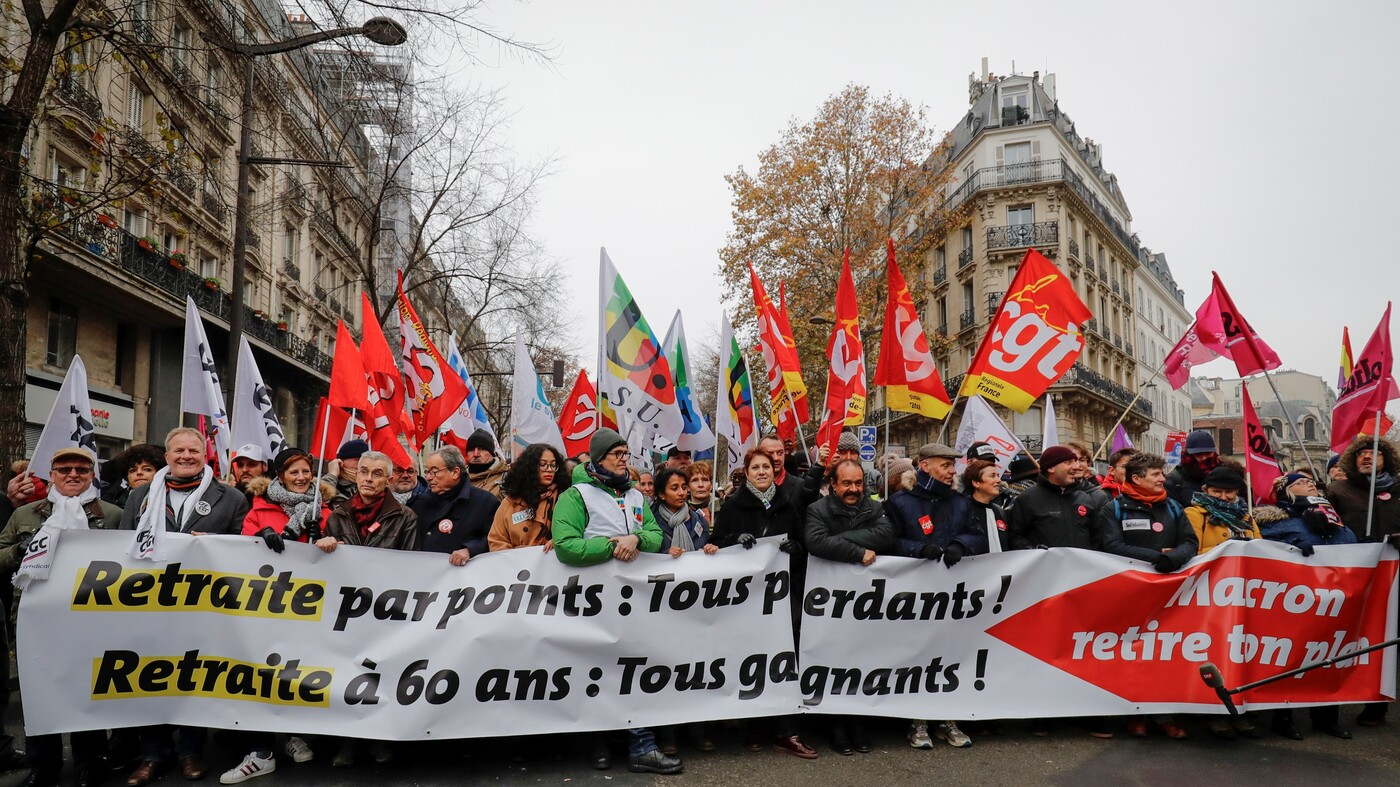 National Strike In France Shuts Down Cities Over Macron's Pension Reform Plans