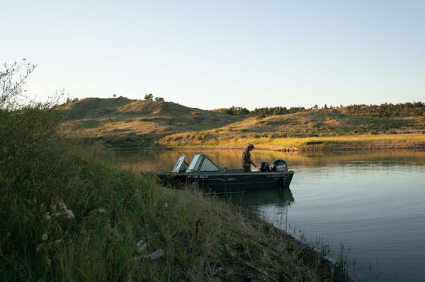 Schaaf starts his boat to head home after scouting for elk.