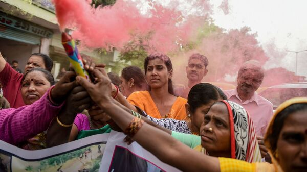 People celebrate after police shot dead four detained gang-rape and murder suspects in Shadnagar, near Hyderabad, India, on Friday.