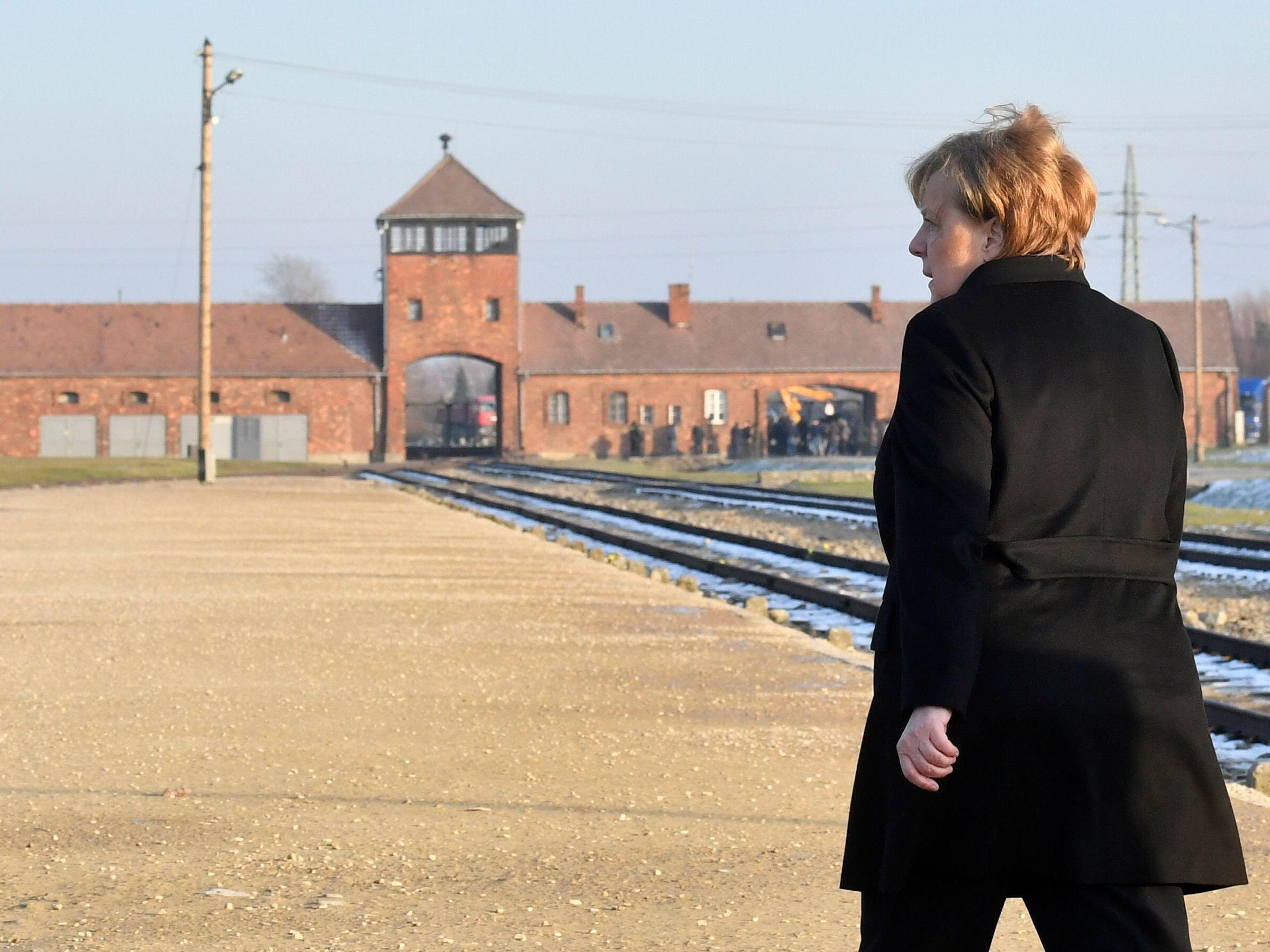 Merkel Tours Auschwitz With 'Sense Of Shame' And Warns Of Resurgent Anti-Semitism