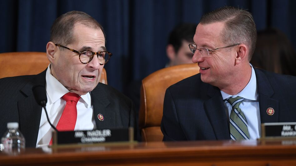 House Judiciary Chairman Jerry Nadler, D-N.Y., speaks with ranking member Doug Collins, R-Ga., at Monday's impeachment hearing. (Saul Loeb/AFP via Getty Images)