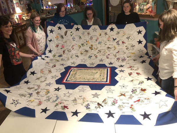 A professional quilter will put the filling and back on the quilt.