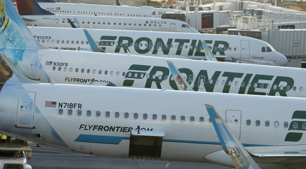 Frontier Airlines jetliners sit at gates on the A concourse at Denver International Airport. Lawsuits filed on Tuesday accuse the airline of discriminating against pregnant and nursing women.