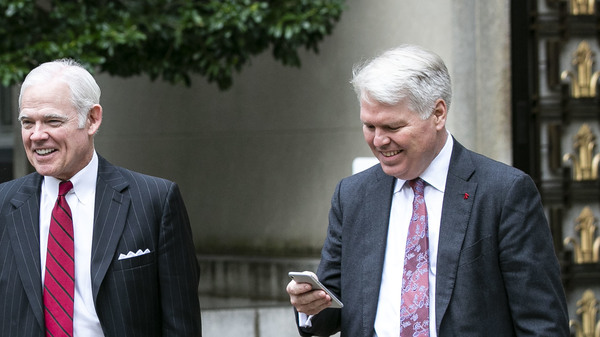 Attorney Charles Cooper, representing former national security aide Charles Kupperman (center) departs federal court in Washington in October. On Tuesday, Cooper asked a federal court to keep alive a lawsuit centered on a now-withdrawn subpoena filed by House Democrats that sought Kupperman
