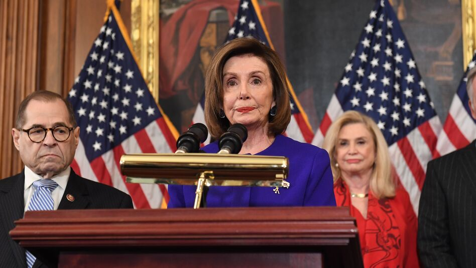 House Speaker Nancy Pelosi and the chairs of investigative committees announce the articles of impeachment against President Trump on Tuesday. (Saul Loeb/AFP via Getty Images)