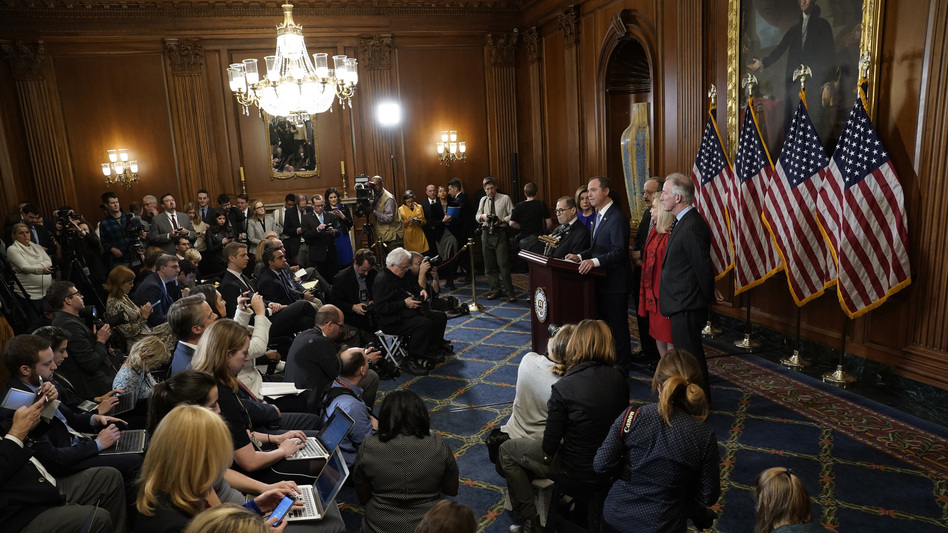 House Speaker of the Nancy Pelosi  joins House investigative committee chairs as they announce articles of impeachment against President Trump Tuesday. (Win McNamee/Getty Images)