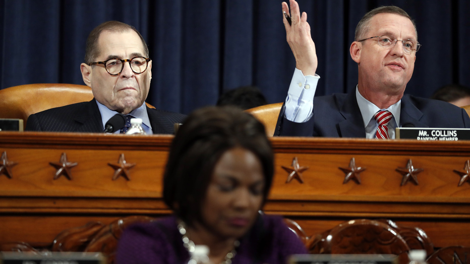 House Judiciary Committee ranking member Rep. Doug Collins, R-Ga., right, gives his opening statement during a House Judiciary Committee markup of the articles of impeachment against President Donald Trump on Wednesday. Committee Chairman Jerry Nadler, D-N.Y., left, looks on. (Jacquelyn Martin/AP)
