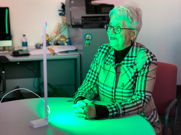 Ann Jones has been spending two hours each day in front of a green LED light as part of an experimental treatment aimed at alleviating migraines and other forms of chronic pain.