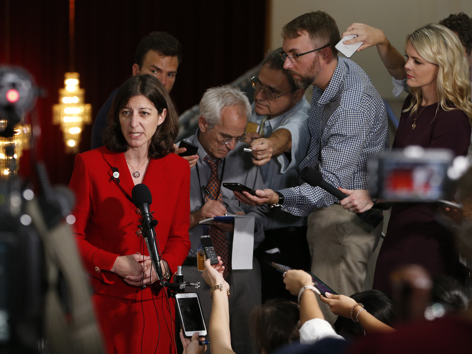 Rep. Elaine Luria answers reporters' questions prior to a town hall at a church in Virginia Beach, Va., in October. (Steve Helber/AP)