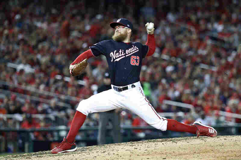 Sean Doolittle of the Washington Nationals delivers the pitch against the Houston Astros during the seventh inning in Game 5 of the 2019 World Series at Nationals Park on Oct. 27.