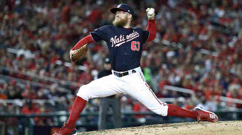 Sean Doolittle of the Washington Nationals delivers the pitch against the Houston Astros during the seventh inning in Game Five of the 2019 World Series at Nationals Park on Oct. 27, 2019 in Washington, D.C.
