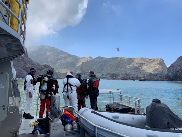 Divers near New Zealand's White Island search for a body after the volcanic eruption earlier this week.