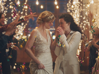 The Hallmark Channel is embroiled in controversy after it pulled an ad by wedding site Zola, which shows a lesbian couple getting married and sharing a kiss.
