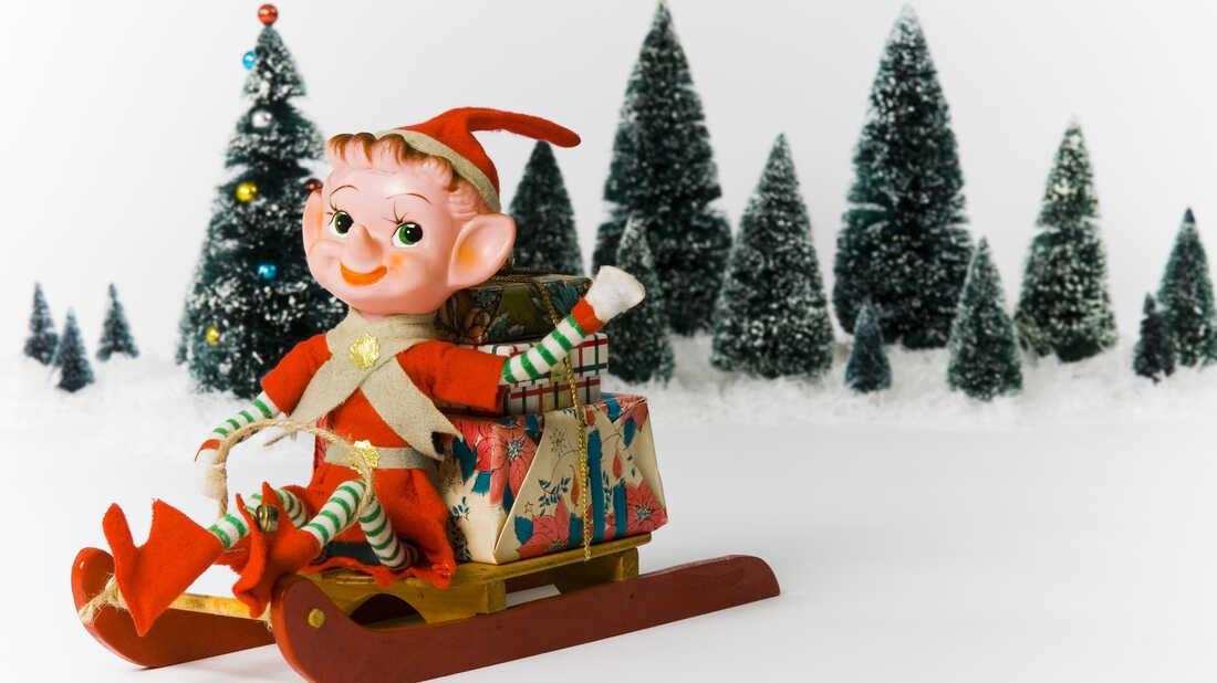 An elf on a sleigh