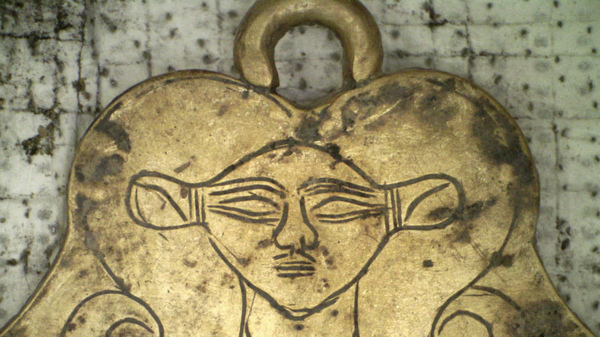 This golden pendant of the Egyptian goddess Hathor was found in one of two 3,500-year-old tombs.