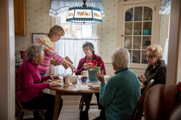 Dorothy Buchanan's daughter, Beth, serves tea, while Dorothy Murray's daughter, Bonnie Parsons (third from left), sits with the three Dots.